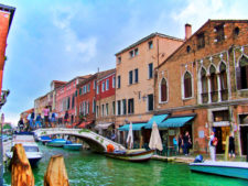Canal and Glass shops on island of Murano Venice Italy 1