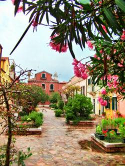 Quiet courtyard on island of Murano Venice Italy 1