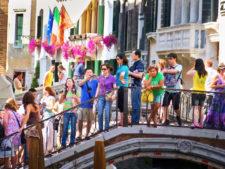 Tourists on footbridge in Venice Italy 1