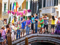 Tourists on footbridge in Venice Italy 1