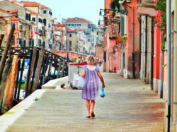 Venetian woman walking along docks in pajamas Venice Italy 1