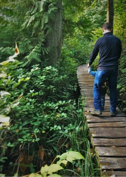 Chris Taylor and littleman on bridge at Cape Flattery 2traveldads.com