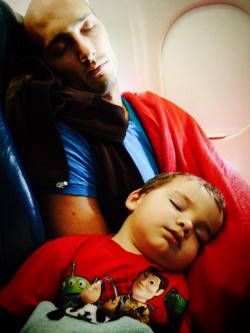 Daddy and LittleMan sleeping on plane