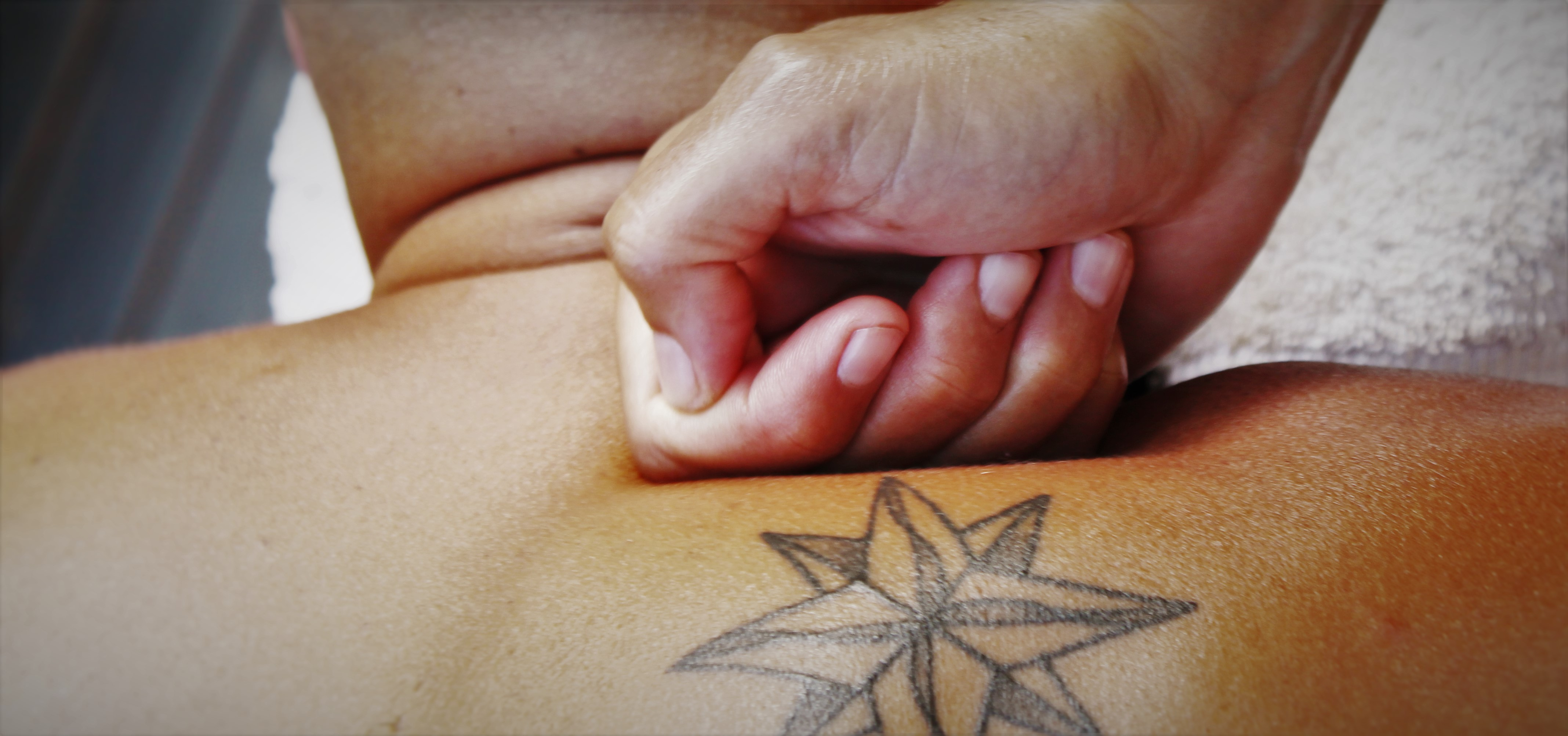 Kelly Blanchard Massaging with Tattoo header