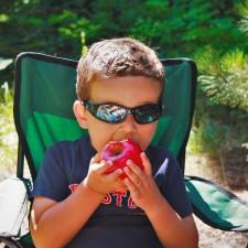 LittleMan eating Apple camping Glacier National Park 1
