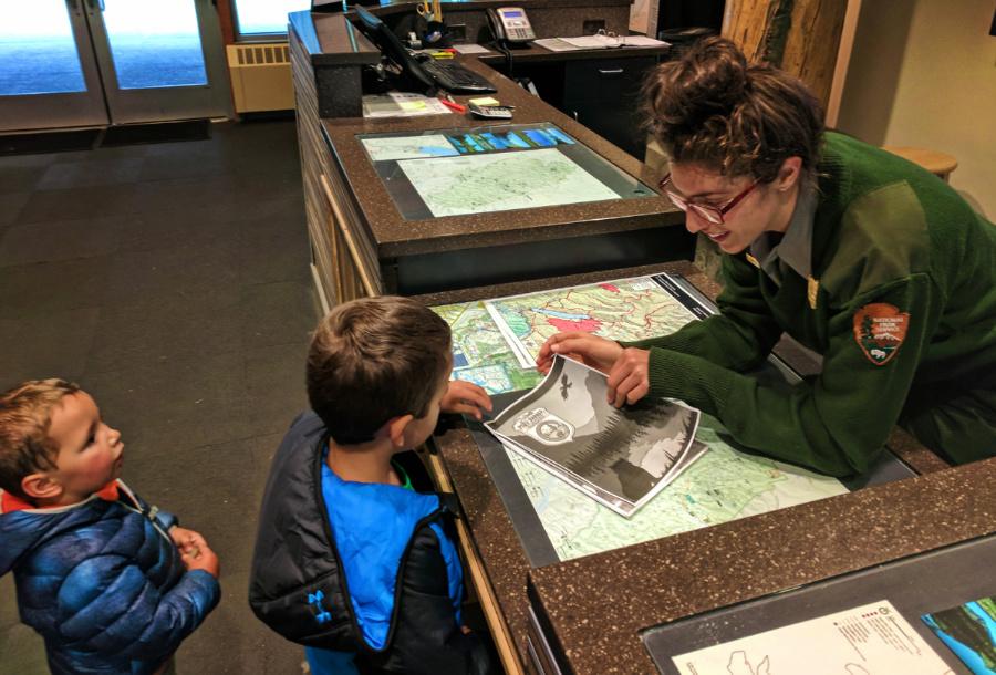 Taylor-Family-completing-Junior-Ranger-program-Apgar-Visitors-Center-in-Glacier-National-Park-1.jpg