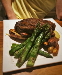 Bison Ribeye with fingerling potatoes and asparagus at Echo Restaurant King and Prince Resort St Simons GA
