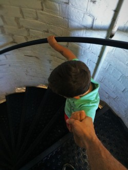LittleMan climbing down spiral staircase of St Simons Island Lighthouse Georgia 2traveldads.com
