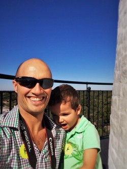 Rob Taylor and LittleMan at the top of St Simons Island Lighthouse Georgia 2traveldads.com