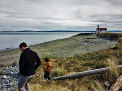 Chris Taylor and LittleMan on beach at Point Wilson Lighthouse Fort Worden Port Townsend 1