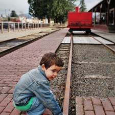 LittleMan Testing Railroad Track at Old Snoqualmie Train Depot Washington 2traveldads.com