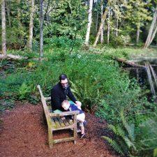 Chris Taylor and TinyMan by still pond at Bloedel Reserve Bainbridge Island 1