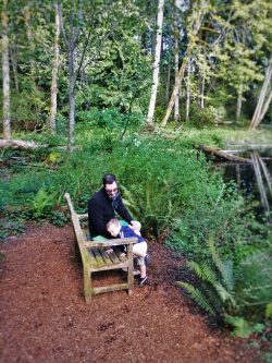 Chris Taylor and TinyMan by still pond at Bloedel Reserve Bainbridge Island 1