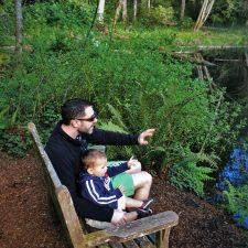 Chris Taylor and TinyMan by still pond at Bloedel Reserve Bainbridge Island 3