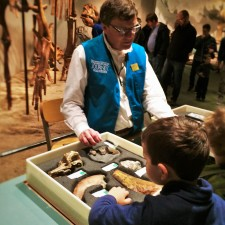 Docent-and-Fossils-at-Prehistoric-Journey-in-Denver-Museum-of-Science-and-Nature-2-225x225.jpg