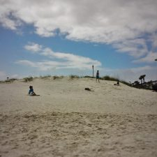 Kids playing on dunes at Jacksonville Beach Florida 1