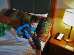 LittleMan in bed at Inverness Hotel Denver Colorado 1