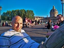 Rob Taylor sitting on Pont des Arts Paris 1