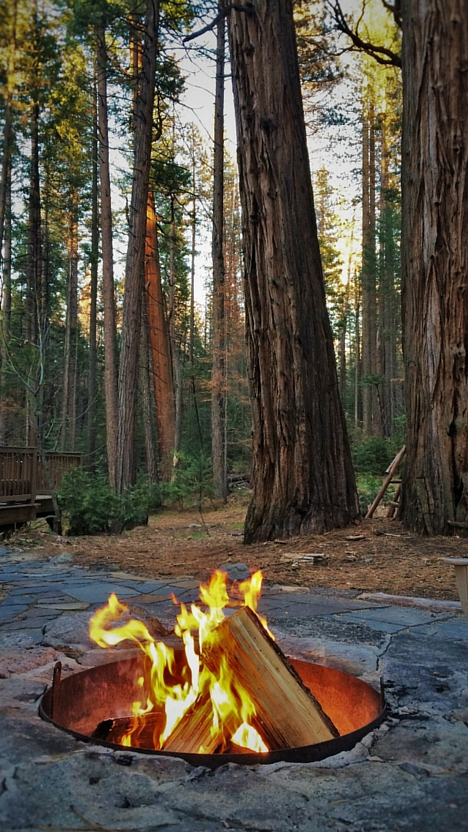 Camp fire in fire pit at Evergreen Lodge Yosemite ...