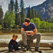 Chris Taylor and LittleMan picnic at Cathedral Merced River in Yosemite National Park 2traveldads.com