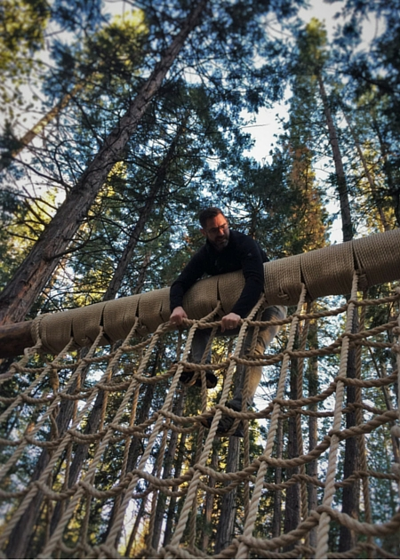 Chris Taylor On Ropes Course At Evergreen Lodge At