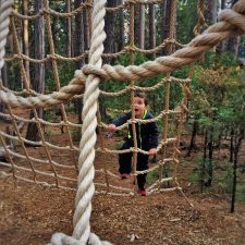 LittleMan-doing-ropes-course-at-Evergreen-Lodge-at-Yosemite-National-Park-1-225x225.jpg