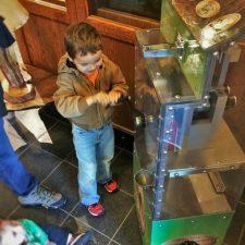 LittleMan making pressed penny at Wuksachi Lodge Sequoia National Park 2traveldads.com