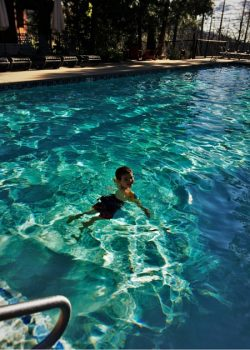 LittleMan swimming at Evergreen Lodge at Yosemite National Park 2traveldads.com