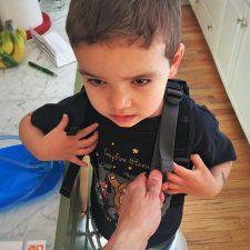 LittleMan trying on Piggyback Rider 2traveldads.com