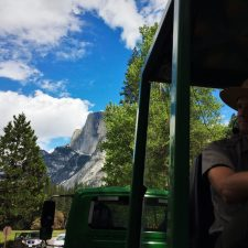 Park Ranger and Half Dome on tram tour of Yosemite Valley Floor in Yosemite National Park 1