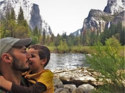 Rob Taylor and LittleMan at Merced River on tram tour of Yosemite Valley Floor in Yosemite National Park 1