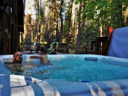 Rob Taylor and TinyMan in hot tub at John Muir House at Evergreen Lodge at Yosemite National Park 1