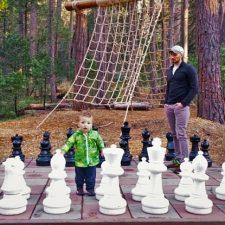 Rob-Taylor-and-kids-playing-mega-chess-at-Evergreen-Lodge-Yosemite-2traveldads.com_-225x225.jpg