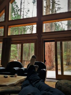 Rob Taylor feet with sequioas in John Muir House at Evergreen Lodge at Yosemite National Park 1