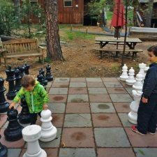 Taylor-Kids-playing-mega-chess-at-Evergreen-Lodge-at-Yosemite-National-Park-1-225x225.jpg