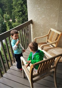 Taylor kids on balcony at Tenaya Lodge Yosemite 2traveldads.com