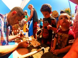 Chris-Taylor-and-Kids-building-boats-at-Anacortes-Waterfront-Festival