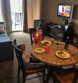 Kids eating dinner Condo unit at Pacific Reef Hotel Gold Beach Oregon Coast