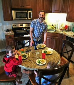 Chris Taylor and Kids eating dinner Condo unit at Pacific Reef Hotel Gold Beach Oregon Coast