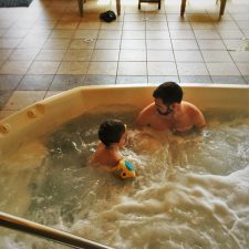 Chris Taylor and TinyMan in Hot Tub cabana at Pacific Reef Hotel Gold Beach Oregon Coast