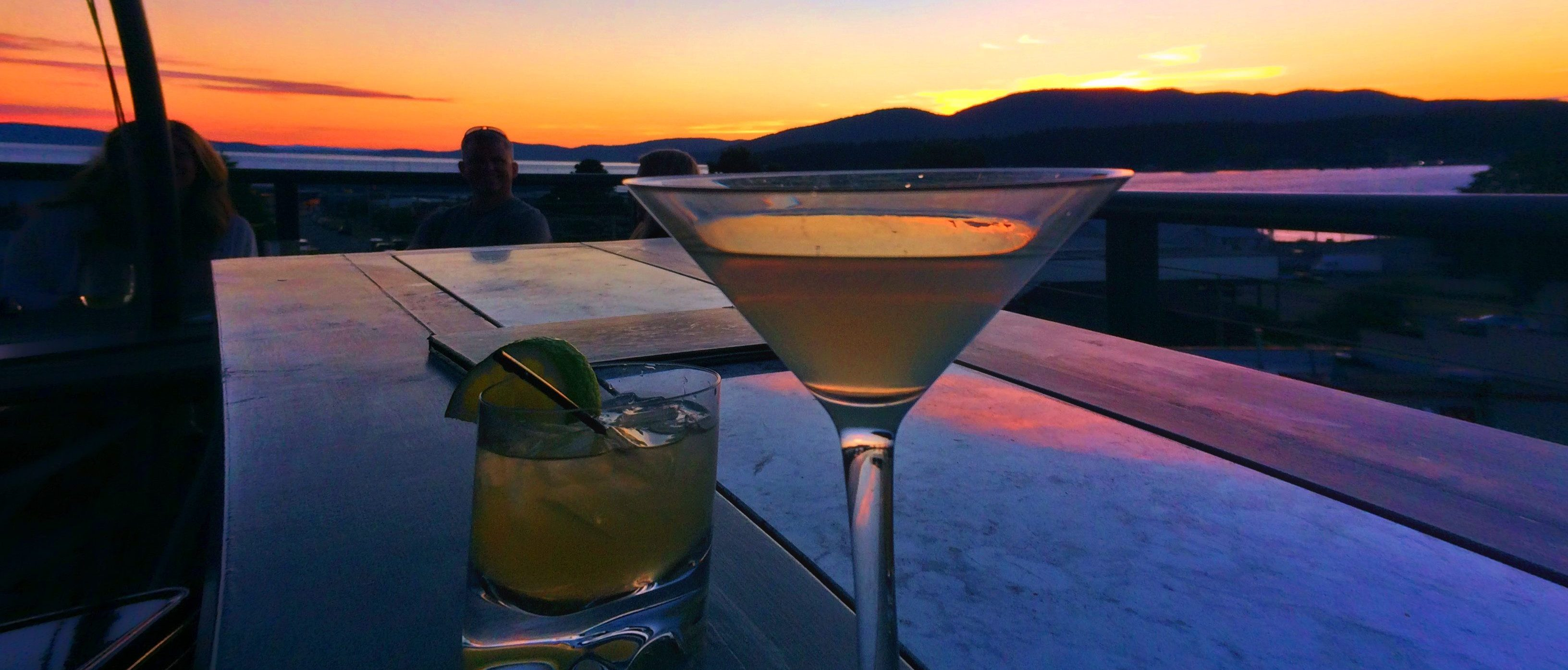 Cocktails at Sunset on Rooftop of Majestic Inn Anacortes header