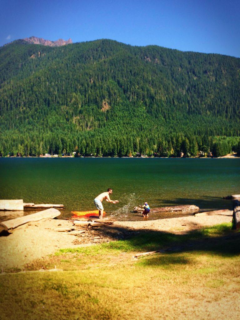 Chris Taylor and LittleMan playing in Lake Cushman Olympic Peninsula 1
