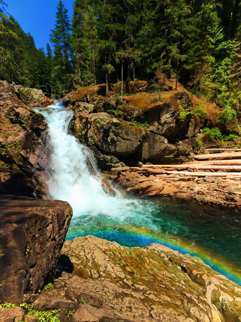 Clear water and colorful rocks and rainbow at Silver Falls Mt Rainier National Park 2