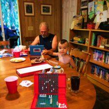 LittleMan-playing-battleship-at-VRBO-at-Lake-Cushman-family-reunion-1-225x225.jpg
