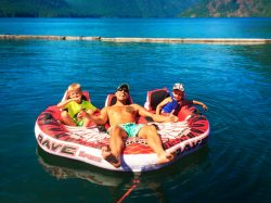 Rob Taylor and kids on inner tube at Lake Cushman Olympic Peninsula 1