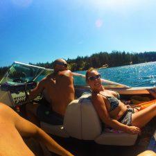 Rob Taylor driving speed boat with family at Lake Cushman Olympic Peninsula