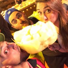 Rob Taylor and friends eating cotton candy in Muslim quarter Xian Shaanxi China 1