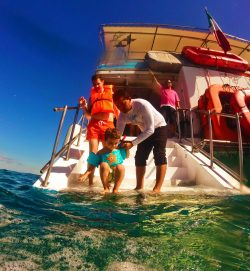 Taylor family snorkeling off the Cabo Escape