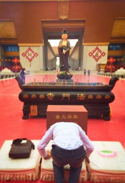 Man praying at Buddhist Famen Temple 1