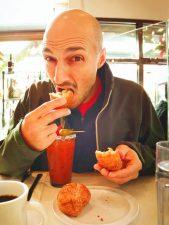 Rob Taylor eating bengets at Cheryls Portland restaurant 1